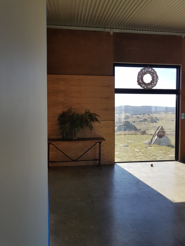 big windows, lots of light, wood offsetting concrete